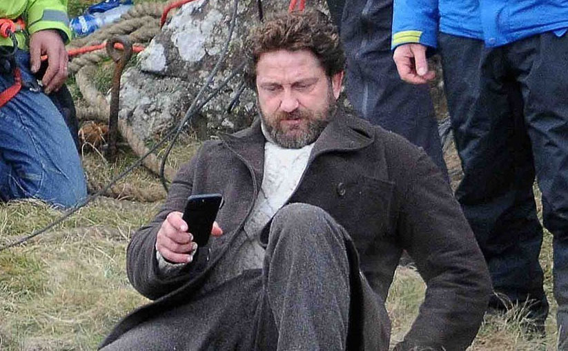 Gerard Butler Loses His Balance On 'Keepers' Set in ...