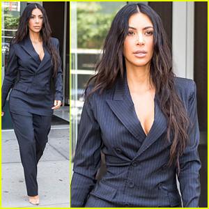 Kim Kardashian Flaunts Her Curves in Pin-Striped Suit
