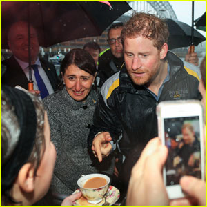 Prince Harry Gets Greeted in Rainy Australia With Hot Cup of Tea