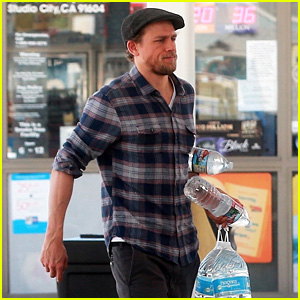Charlie Hunnam Stocks Up on Bottled Water at the Gas Station