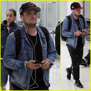 Josh Hutcherson Wears a Leg Brace While Walking Through LAX
