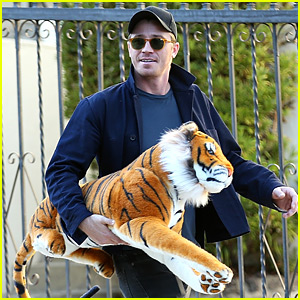 Garrett Hedlund Carries Giant Stuffed Tiger Around the Neighborhood