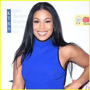 Jordin Sparks Cradles Baby Bump in 'Baby's First Christmas' Sweater!