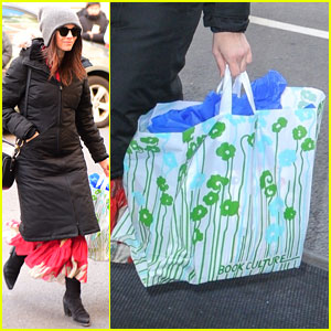 Abigail Spencer Arrives to Meghan Markle's Baby Shower Holding Blue Gift Bag