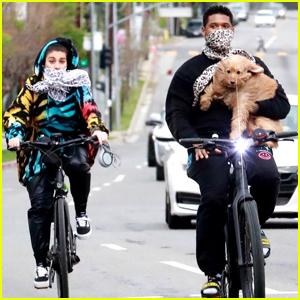 Usher Carries His Dog on Bike Ride with Girlfriend Jennifer Goicoechea