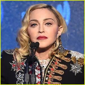 Madonna Goes Topless & Poses with Her Crutch - See Photo!