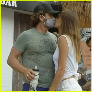 Gerard Butler Kisses Girlfriend Morgan Brown Through His Mask!