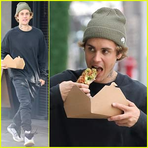 Justin Bieber Eats His Lunch While Walking Around L.A.