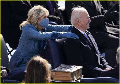 First Lady Jill Biden squeezes President Joe Biden's shoulders