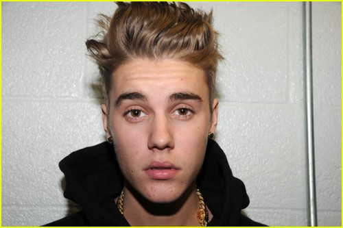 Photos documenting Justin Bieber's tattoos from arrest in 2014