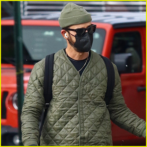 Justin Theroux Stays Warm While Walking Dog Kuma in NYC