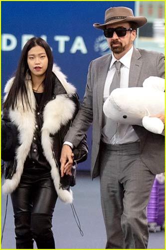 Nicolas Cage and Riko Shibata at airport