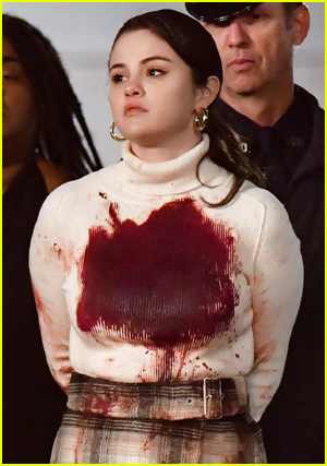 Selena Gomez bloody in a white top walked out by cops