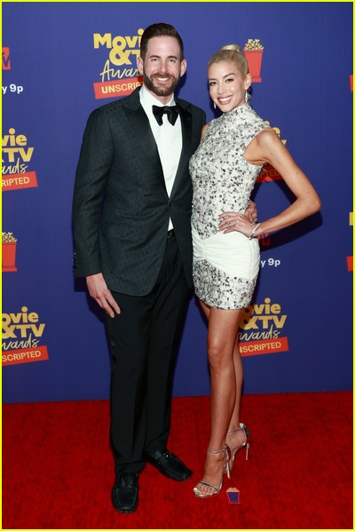 Tarek El Moussa and Heather Rae Young on red carpet at the MTV Movie and TV Awards Unscripted