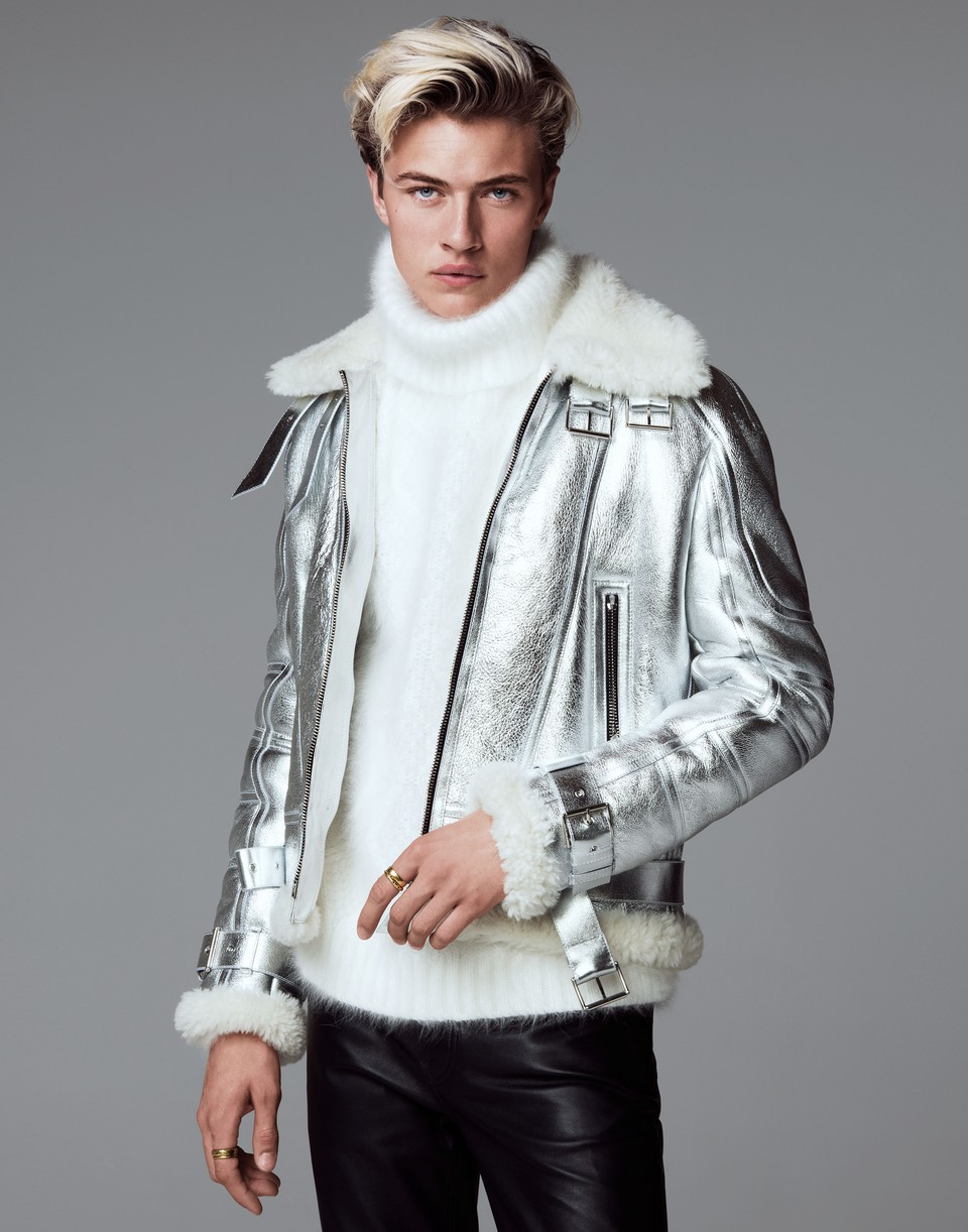 Lucky Blue Smith wears a metallic Versace jacket and leather jeans